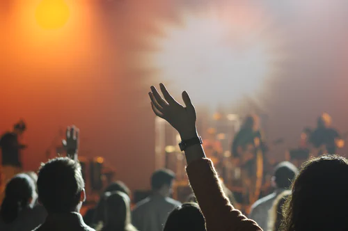 People sing and praise God in a worship service.