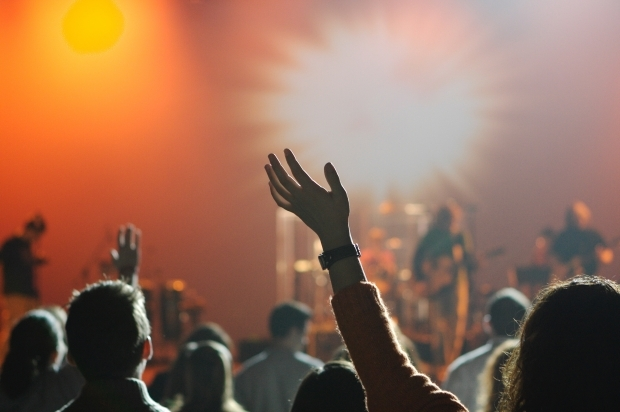 People worship God in a church service.