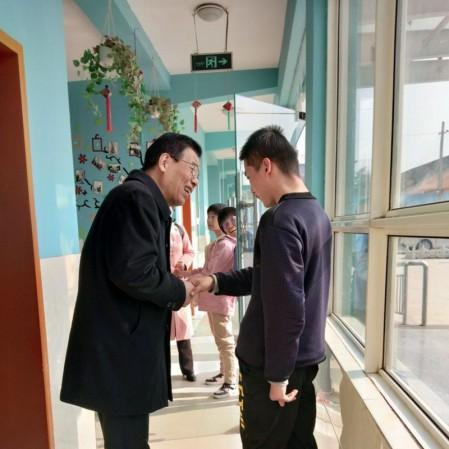 Elder Fan Kexiao from the church in Fufeng County talked with the disabled child in Xinyue Handicapped Children's Center in Jiangzhang Town, China's northern Shaanxi Province on November 10, 2020.