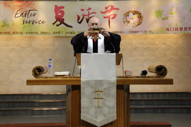 Senior Pastor Yan Peng blessed over Baptismal Water during the Easter service at Haikou Road Church in Changchun, Jilin Province, on April 4, 2021.