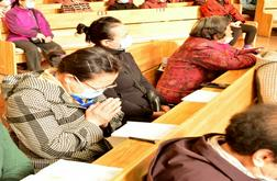 Believers listen to a sermon carefully, with one praying.