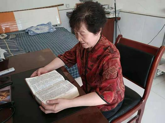Song Qinghua read the Bible at her home in early September 2021.