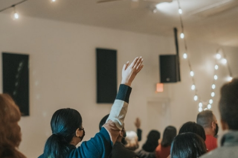 People worship in a house church.