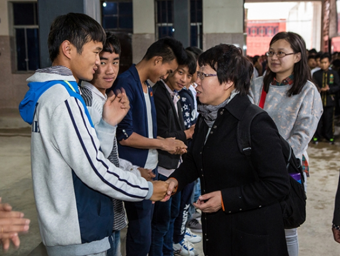 Rev. Bian Wenai and other church co-workers of Haidian Church with the students of Yiliang Christian Training Center on April 3, 2016.