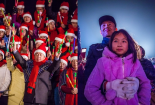 Church staff lead the crowd in carols (left); A father held his daughter during the tree lighting ceremony (right).