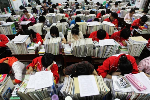 "A group of Chinese students reviewing for the national college entrance exams or ""gaokao."""